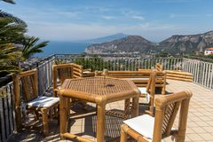 Chairs and table on the terrace overlooking the Bay of Naples and  Vesuvius. Sorrento. Italy Royalty Free Stock Photography