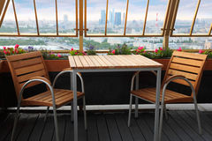 Chairs and table at terrace in restaurant Stock Images