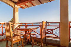 chairs and table on terrace with sea views Stock Images
