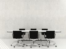 Chairs and table to face a blank wall Stock Photo