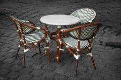 Chairs and Table. White and brown chairs and table ensemble on cobblestone Stock Images
