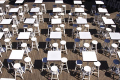 Chairs and tables. White chairs and tables in the restaurant Stock Images