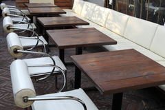Chairs and tables. Some chairs and tables are put at roadside of a coffee bar Royalty Free Stock Photography
