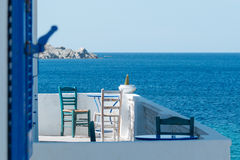 Chairs and tables on a balcony with a view of the sea. Royalty Free Stock Image