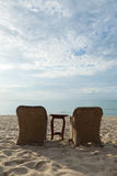Chairs and tables on the beach royalty free stock photos
