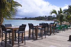 Chairs and tables at a beach restaurant Royalty Free Stock Photos
