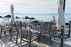 Chairs and tables with beautiful sea view Royalty Free Stock Images