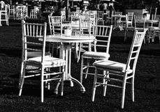 Chairs and tables in garden Royalty Free Stock Images