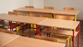 Chairs and tables inside empty classroom in primary school Stock Photo