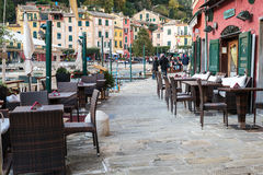 Chairs and tables of Italian cafe at coast of Portofino town, Liguria, Italy Royalty Free Stock Photos
