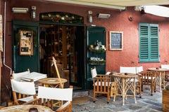 Chairs and tables of Italian cafe at coast of Portofino town, Liguria, Italy Stock Photos
