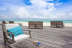 Chairs and tables by the ocean Royalty Free Stock Images