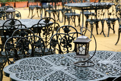 Chairs and tables. With old lantern Royalty Free Stock Photography