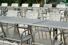 Chairs and tables outdoors Royalty Free Stock Photos