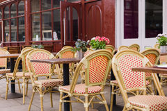 Chairs and tables outside cafe Stock Photo