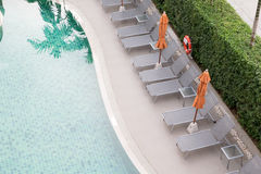 Chairs and Tables with a part of swimming pool in top view Royalty Free Stock Photo
