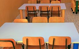 Chairs and tables of a refectory in kindergarten Stock Photos