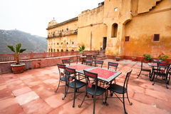 Chairs and a tables in a restaurant on the roof of the fort Stock Photo