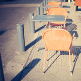 Chairs and tables in the sidewalk Royalty Free Stock Image