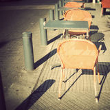 Chairs and tables in the sidewalk Stock Photo