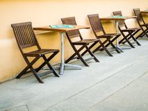 Chairs and tables on the street - coffe, pub. Restaurant, summer time setting Royalty Free Stock Photography