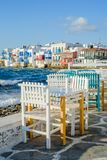 Chairs with tables in Greek tavern in Little Venice part of Mykonos town, Mykonos, Greece stock photo