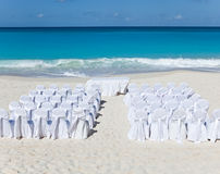 Chairs and tables waiting Wedding on tropical beach.Landscape in a sunny day Stock Images