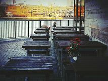 Chairs tables wooden architecture object city centre. Panorama programme restaurant bar bistro Stock Photos