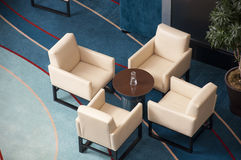 Chairs and tea table. Four chairs and a tea table in a lounge royalty free stock photography