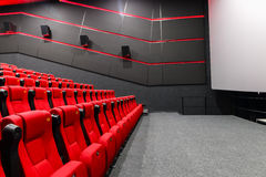 Chairs in a theater. Red chairs in the cinema Royalty Free Stock Images