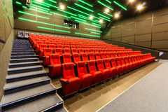 Chairs in a theater. Red chairs in the cinema Royalty Free Stock Photo