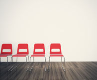 Chairs to face a blank wall Royalty Free Stock Photo