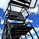 Chairs to heaven. Gigantic sculpture of the Mariscal studies stock photo
