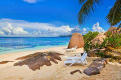 Chairs on tropical beach Stock Images