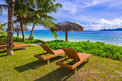 Chairs on tropical beach Stock Photos