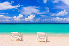 Chairs on tropical beach Royalty Free Stock Photography