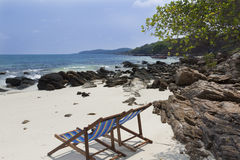 Chairs on tropical beach Royalty Free Stock Photo