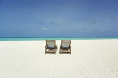 Chairs on tropical beach Royalty Free Stock Images
