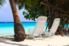 Chairs on tropical beach. Abstract vacation background royalty free stock photos