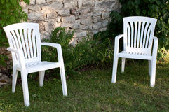 Chairs. Two empty plastic chairs in the garden Royalty Free Stock Image