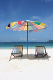 chairs with umbrella Stock Images