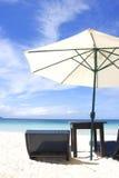 Chairs and umbrella on beach Stock Photos