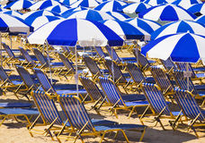 Chairs and umbrella at beach. Chairs and umbrella at tropical beach - vacations background Stock Photo
