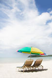 Chairs and umbrella on beach Stock Photography