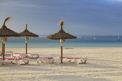 Chairs and umbrella on the beach stock image