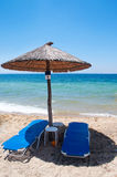 Chairs and umbrella on the beach Stock Photography