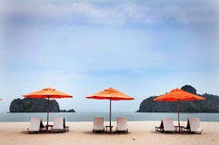 CHAIRS AND UMBRELLA ON BEACH IN LANGKAWI. Beds and umbrella on a tropical beach.Tanjung Rhu.Langkawi Stock Photos