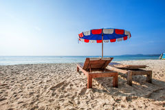 Chairs and umbrella on a beautiful beach. Royalty Free Stock Image