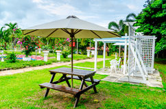 Chairs and umbrella at the garden Royalty Free Stock Image