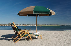 Chairs and umbrella on relaxing white sand beach. Mission bay California in front of a resort Stock Photos